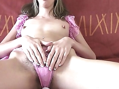 Chick takes down her pink clothes and masturbates