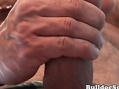 Muscular leather bear pulling his hard cock
