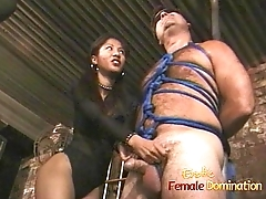 Lovely Asian bitch enjoys pleasuring bound and blindfolded white stud