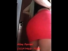 Escort Aline Ferrari make amateur video in her flat wearing red skirt