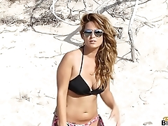 Busty Sarah does a topless photoshoot on holiday