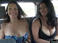 Two pretty women flash their big boobies for some money